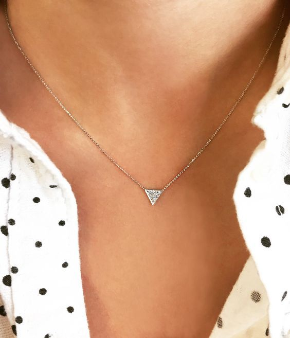 Sweet and simple Emily Sarah diamond triangle necklace                                                                                                                                                                                 More