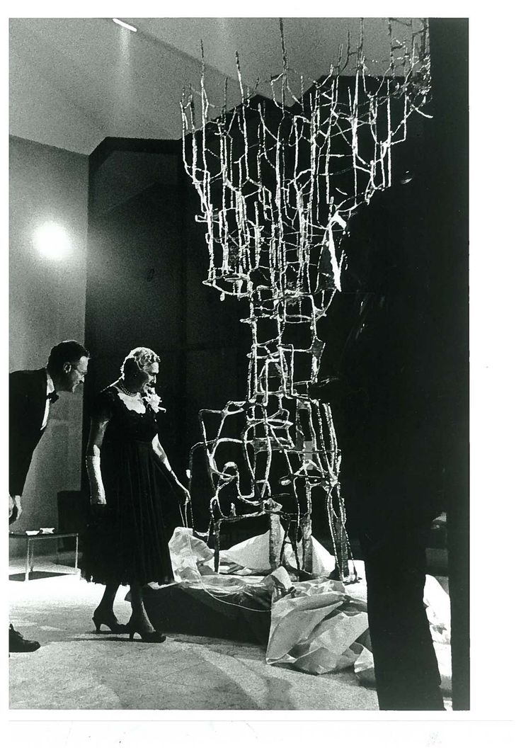 """Etta Steinberg is pictured at the inaugural opening of Steinberg Hall in 1960. Mrs. Steinberg looks at Ibram Lassaw's """"Presence,"""" which she gave to the Washington University Gallery of Art in 1960."""