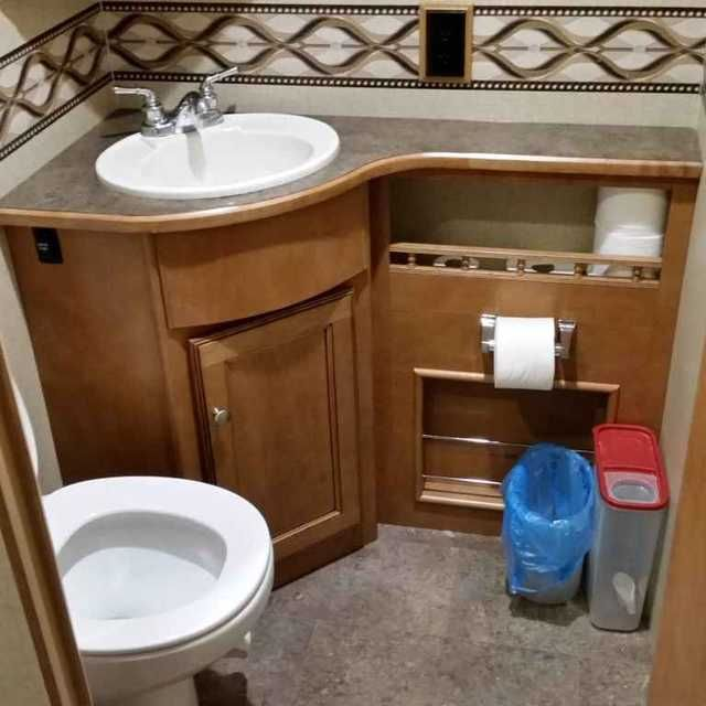 """2015 Used Winnebago Vista 35B Class A in Alabama AL.Recreational Vehicle, rv, Spacious 3-slideout bunk house model with 1-1/2 baths. It has one of the larger showers in the RV industry. There are two TVs inside, a 48"""" TV in the main living area, and one 28"""" TV in the back bedroom. The main living area TV is connected to an onboard DVD player in the entertainment player of front area. Unit is prepped for Satellite connection(s) and has a factory installed King over the air antenna. Slide outs…"""