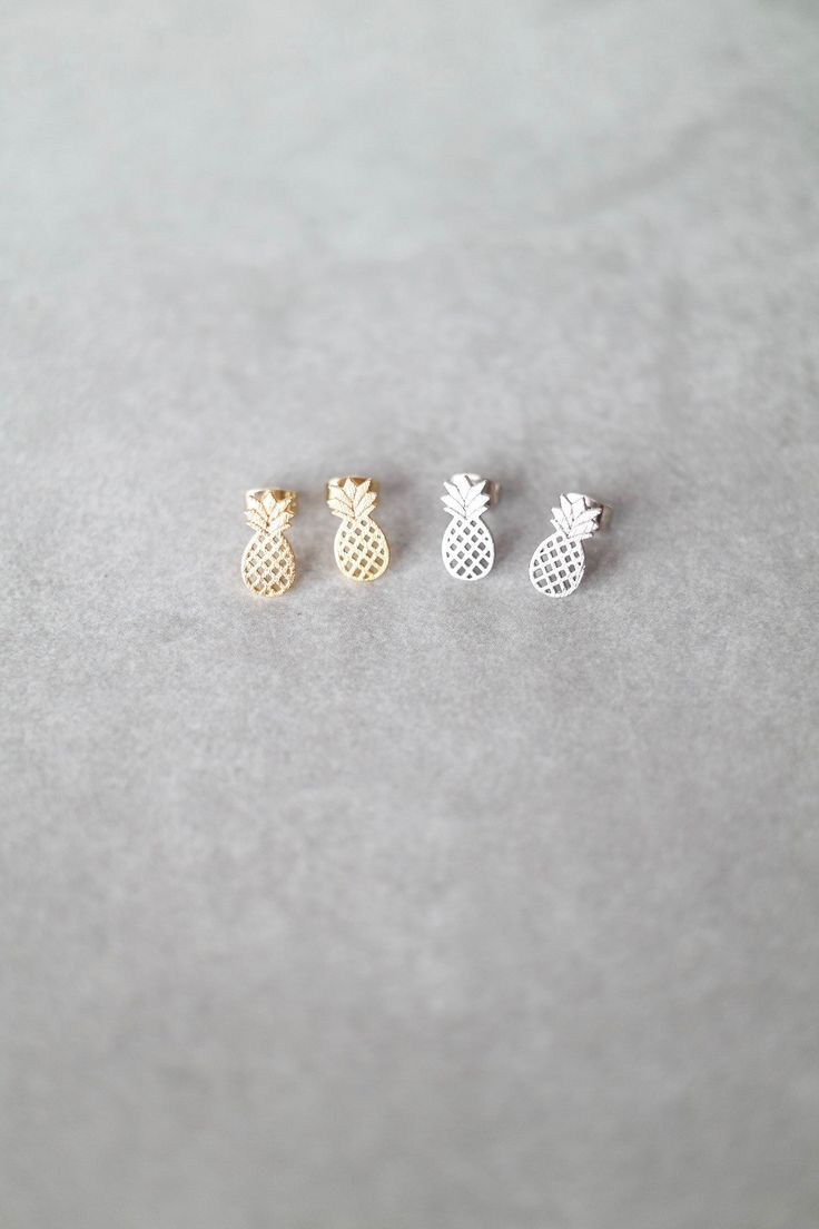 "Make your outfit even sweeter with this tiny pineapple studs! Details: - 1/2"" drop - Post back"