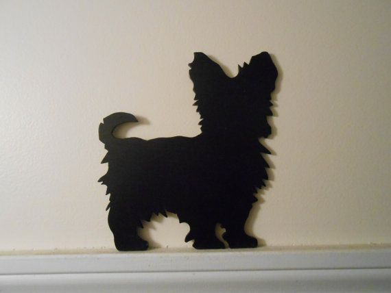 Now we have some Dog Silhouettes to top your doors or windows. Made with thin plywood, sanded smooth then finished with two coats of black water based acrylic paint then sealed with two coats of water based polyurethane to prevent marring your walls The Yorkie is 7 3/8 inches high
