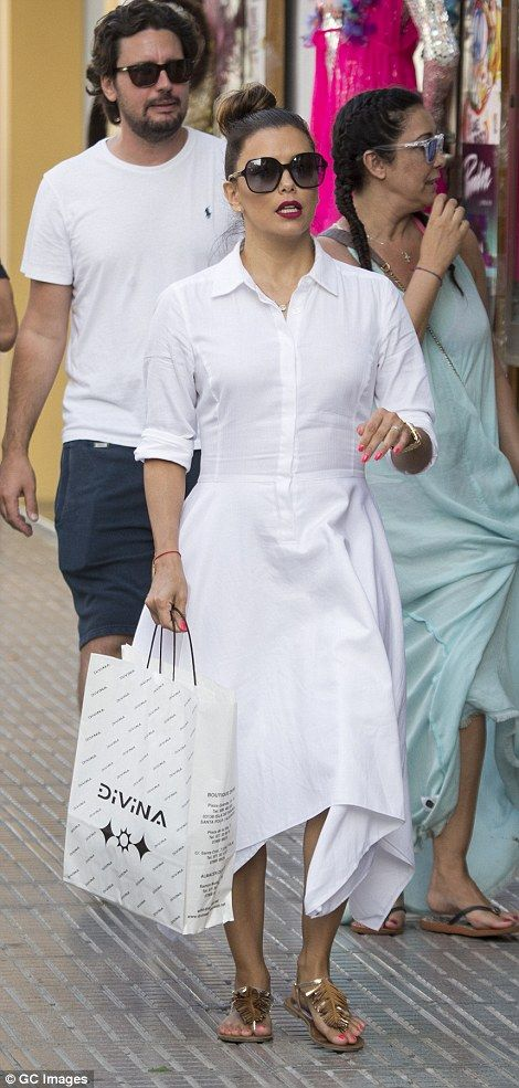 Eva Longoria swapped the red carpet for the shores as she was pictured larking around on a beach with her husband José Bastón in Formentera