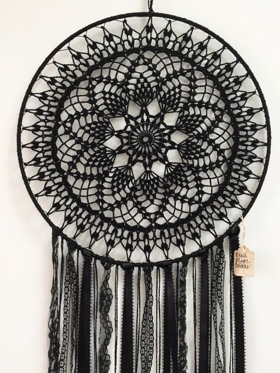 This black magic dreamcatcher is the perfect addition to your midnight bohemian style. Black crochet doily, black lace, black raven feathers.  {Item Description}  Dimension: 15 hoop, 36 length (overall) Doily: black yarn Feathers: black raven feathers (cruelty free) Thread: black braided   Thanks, Enjoy