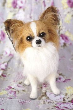 A tiny needle-felted papillion dog created by Mido Felt, brown and white colors (pinned from Mido Felt's own website by Nancy Lee Moran Fine Art) #needlefelting #papillion #dog