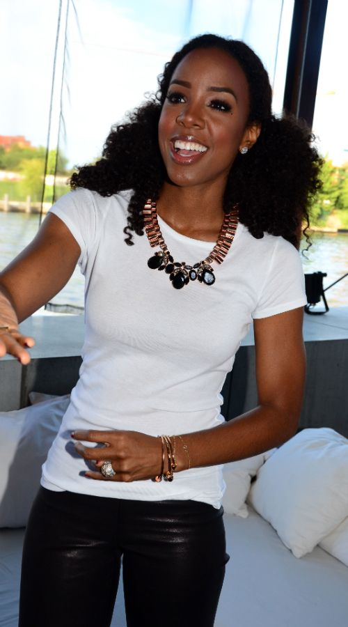 Kelly Rowland kept her look simple in a white t-shirt, black leather leggings, and peachy Christian Louboutin Pigalle pumps. She added some visual interest to her outfit with a $1,018 statement necklace from Mawi's Fall 2012 collection. - From FashionBombDaily