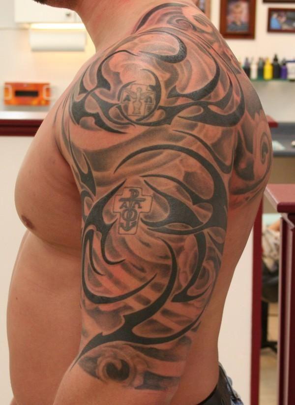 Tribal, half sleeve tattoo on TattooChief.com