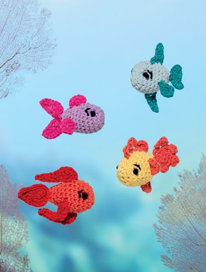 I'd love to make a sea themed kids mobile out of these little fishies
