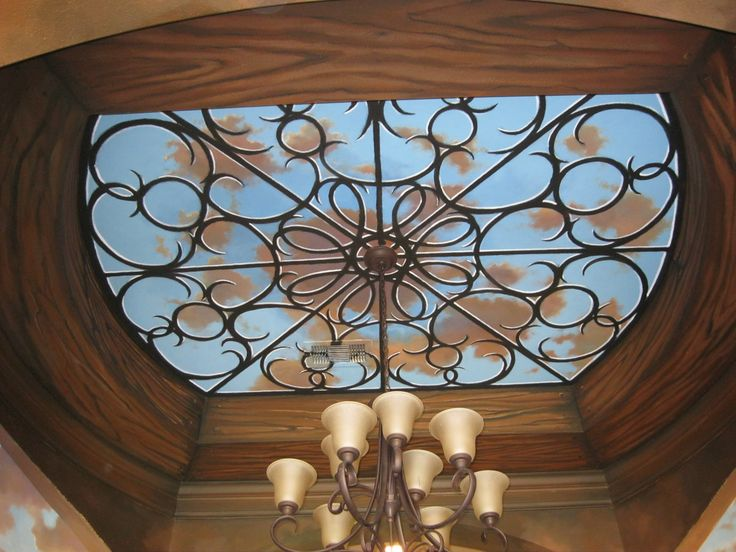 Faux wood and iron, blue sky Mural.      www.dwcustommurals.com, Dream Walls Murals and Faux Finish, By Artist Alfredo Montenegro