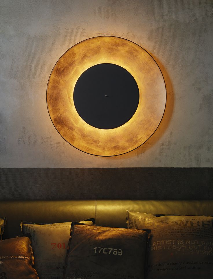 #lunaire by férreol babin. Copper Leaf covered reflector and black front disc
