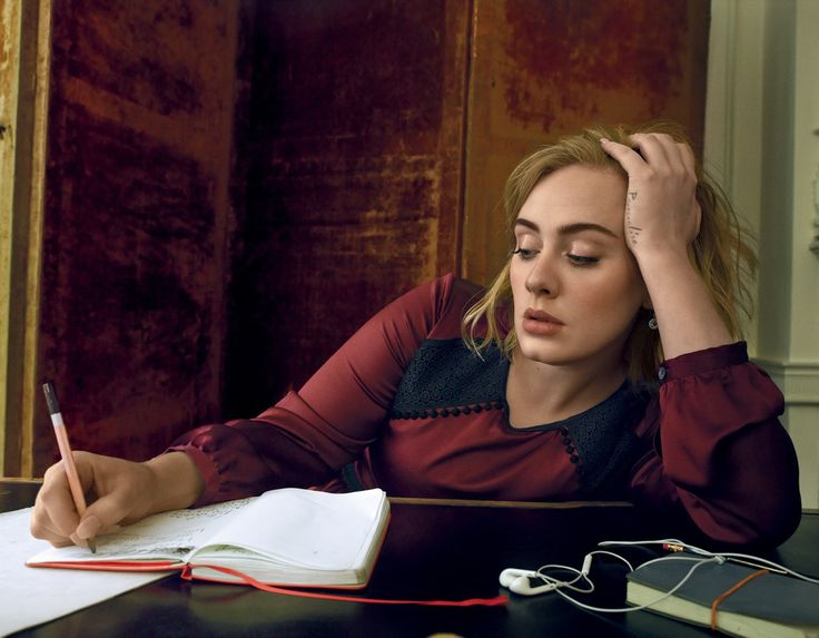 Adele writing wearing a Burberry dress for Vogue US, March 2016. Photograph by…