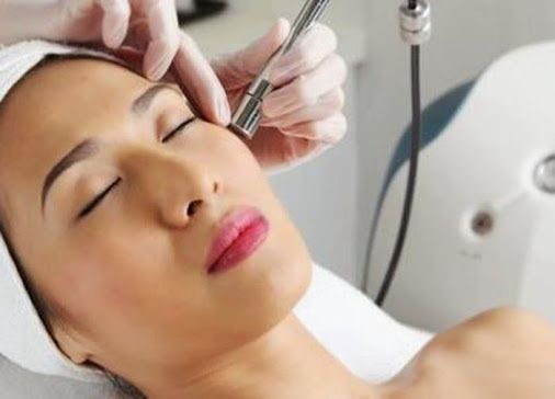 Microdermabrasion treatment is useful for treating light scarring, discoloration, sun damage, hyperpigmentation, age spots, fine lines, wrinkles and enlarged pores.