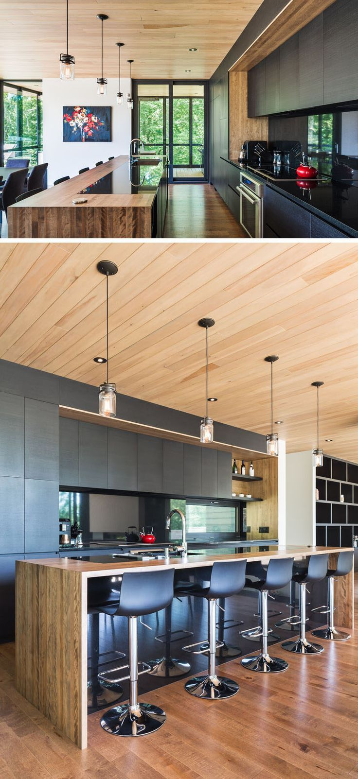 In this kitchen, black ash colored cabinetry without hardware has been combined with wooden elements to create a seamless contemporary look that contrasts the white walls.