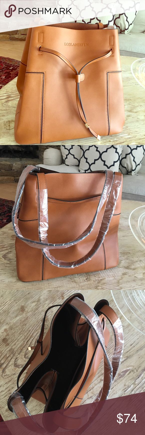 """New Tote 👜 Medium Shoulder bag beautiful Saddle Brand new Tote or shoulder (hand) bag in gorgeous faux ( great fake) leather. Tan, brown, really saddle color. And gold hardware. Comes with dust cover. 10.5"""" wide, 11"""" tall x 7"""" deep. Ships 🚢 immediately from top seller in all categories. loslandifen Bags Shoulder Bags"""