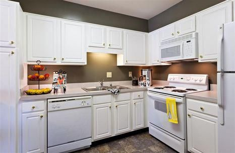 Fully equipped cabinetry with maple or white cabinetry.  All of our kitchens come with a microwave and refrigerator. #AGranderLifestyle www.ntshurstbourne.com