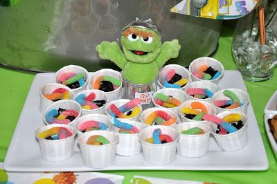"Oscar the ""Grouch"" dirt trash cans with pet worm ""slimy"" - using crushed oreos and sour worms. Kids LOVED these!"
