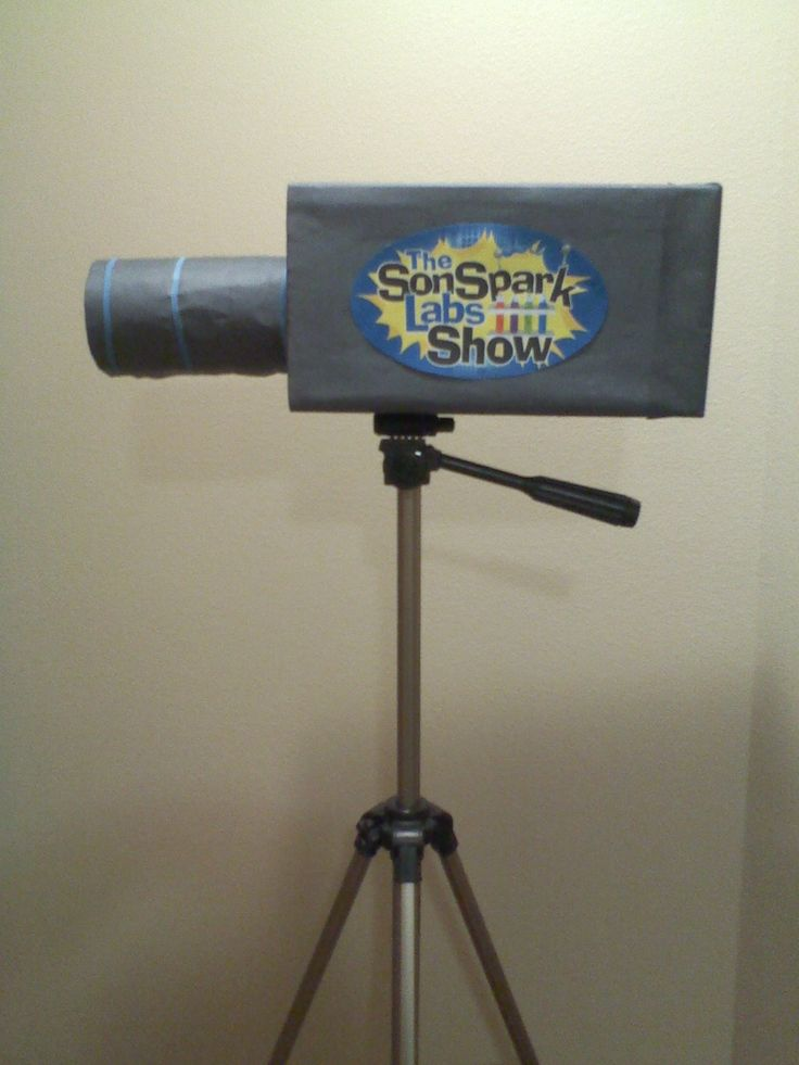Movie Camera for the 'Show' area:  shoe box + peanut butter jar + black paper + printable SonSparks Lab Show emblem from the Decor & More pack; sits on a camera tripod