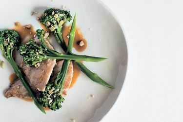 Pan-fried fish fillets with sweet stem broccoli and Asian sauce