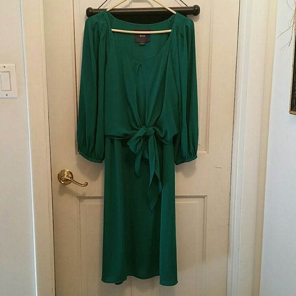 Emerald Green anthropology dress Great dress. It is a 12. I bought from another posher but lost 44.2 pounds an it is to big. My loss it's a beautiful knee length dress. Light weight material. Maeve  Dresses Midi