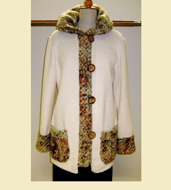 Kabátek+Kabátek+je+ušity+z+úpletové+kabátoviny.+Bílý+úplet+imituje+beránčí+rouno.Velikost+kabátku+je+44-46.