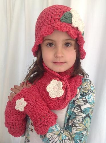 Miss Muffet beanie, buttonhole scarf and wrist warmers in nwe rasberry.