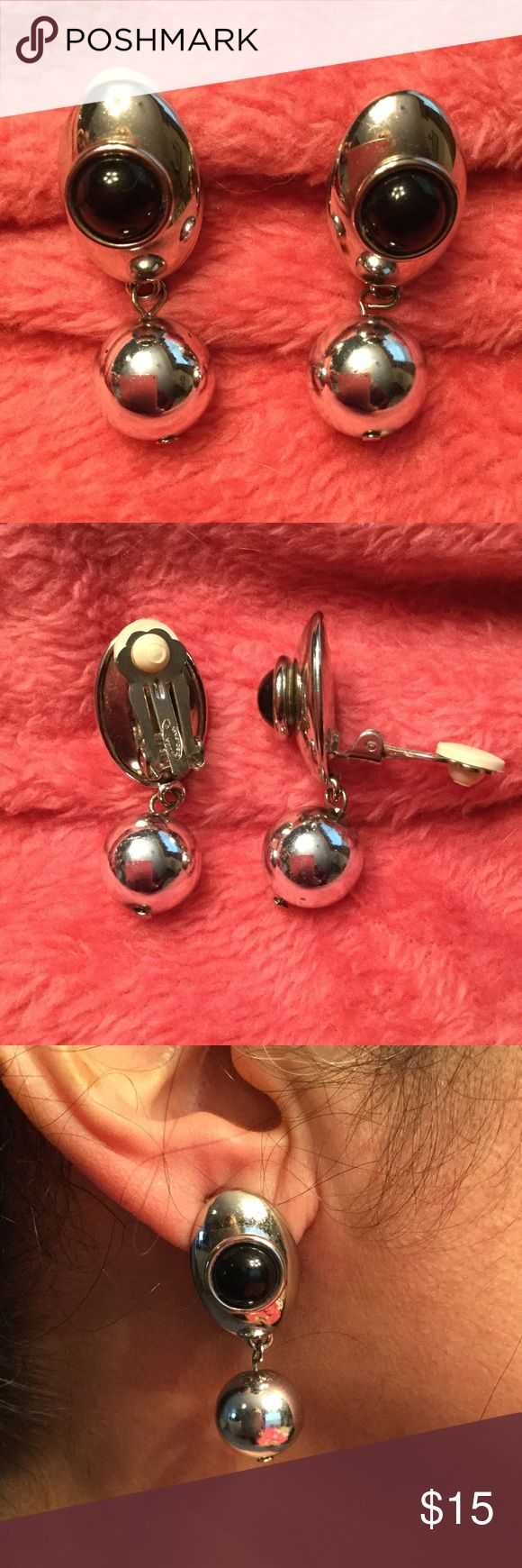 Silver and black dangle costume clip on earring Ellen Designs silver and black dangle style clip on earrings.  Smooth black faux onyx stone with silver ball. Overall size is 1-1/2 inches. Gently used and in excellent condition. Ellen Design Jewelry Jewelry Earrings