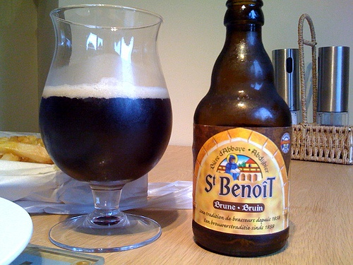 Trying out: St Benoit Brune. 7/10. Color: Dark brown Type: Belgian origin Alcohol percentage: 6,5 % Rec. serving temperature: 8° - 12°C   46° - 54°F Brewery: Brasserie Du Bocq Country: Belgium 0 St. Benoit Brune is a top-fermented beer that is re-fermented in the bottle. It has a slightly fruity aroma, with a dominant smell of liquorice and caramel. The Brune has a slightly bitter flavour with dark malt giving off a note of black chocolate combined with a hint of fruit.