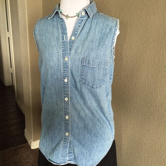 "VINTAGE GAP Sleeveless Denim Shirt  Great vintage condition. 100% Cotton. Vintage sizing, so please make sure measurements below work for you. Care instructions:  Machine wash, warm.  Approximate Measurements  Bust- almost 38"" unstretched Length from shoulder to tail- almost 27.5"" unstretched GAP Tops Button Down Shirts"