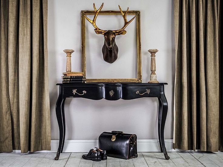 Classic console table with ornate brass detailed handles