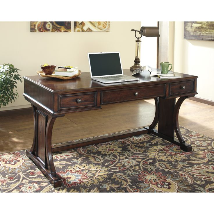 This gorgeous home office desk features a beautiful medium brown finish and pullout tray for a keyboard. Center your home office around this durable, contemporary desk.