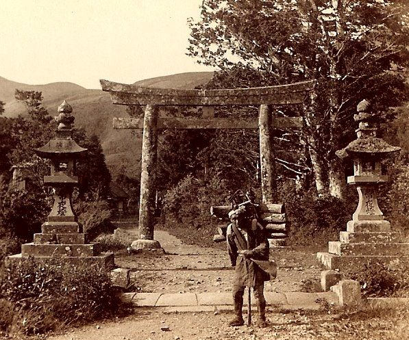 Old woodcutter coming home from the mountains through the ancient temple grounds in Hakone, ca. 1898