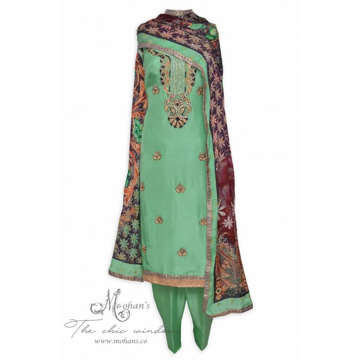 Pretty sea green unstitched suit featuring in rich ornate embroidery-Mohan's the chic window