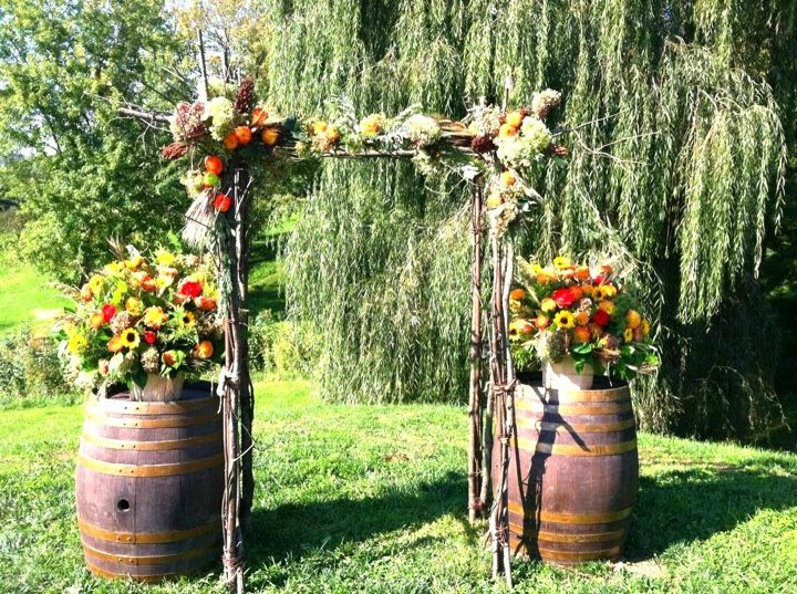 Vineyard wedding at Sunset Hills in Purcellville, VA.  We built this rustic branch arch for this fun Fall wedding.  Flowers by Amy Potter   Country Way Floral & Event Design Studio