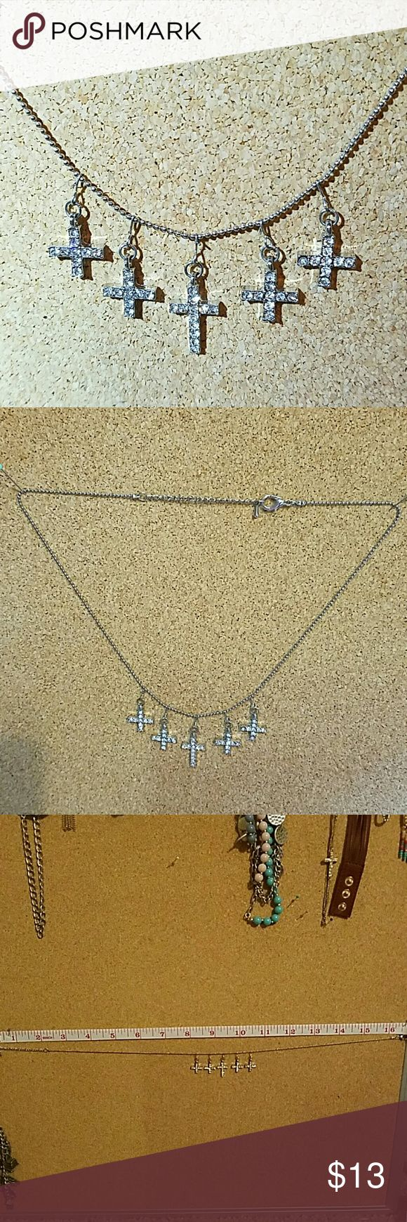 "Silvertone rhinestone 5 crosses necklace Very pretty and dainty with a lot of sparkle! On the small side, could either be a childs necklace or a short womens. Measures 15"" - 17"" in length. Worn once, no missing stones or discoloration. none Jewelry Necklaces"
