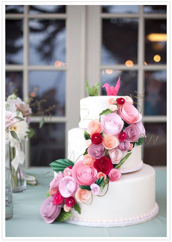 paper flower adorned wedding cake