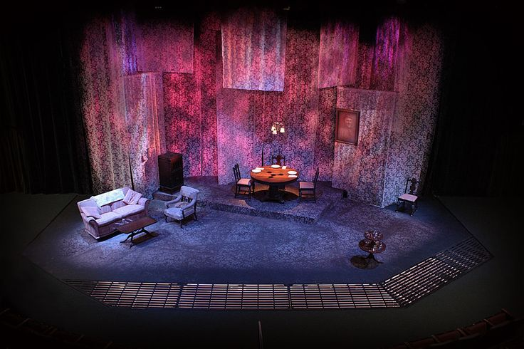 I love the extensive use of fabric pattern in the draped space of this Glass Menagerie set by Mike Buckley for Lamb's Players production