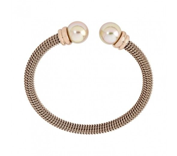 A stylish bangle with round pearl accents from the 'Modern Metals' design... #Majorica #finejewelry #gold #bangle #pearls #janesjewelers