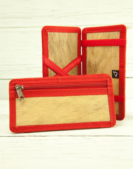 WitchWallet Made mostly of palm tree fiber with a slim design (1cm thick) for those who want to carry only the necessary stuff, even though you can carry up to 10 cards or documents and a good chunck of money, also have a safe pocket with zipper.