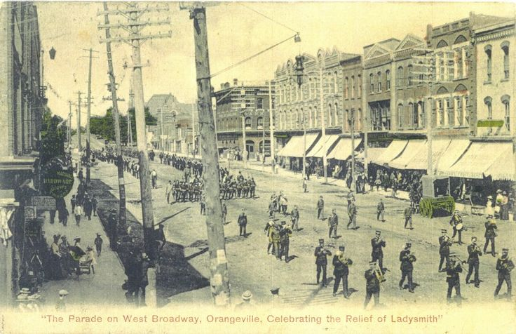 This photo shows a parade on West Broadway celebrating the Relief of Ladysmith.  Photo courtesy of the Dufferin County Museum & Archives. Photo Number P-0548