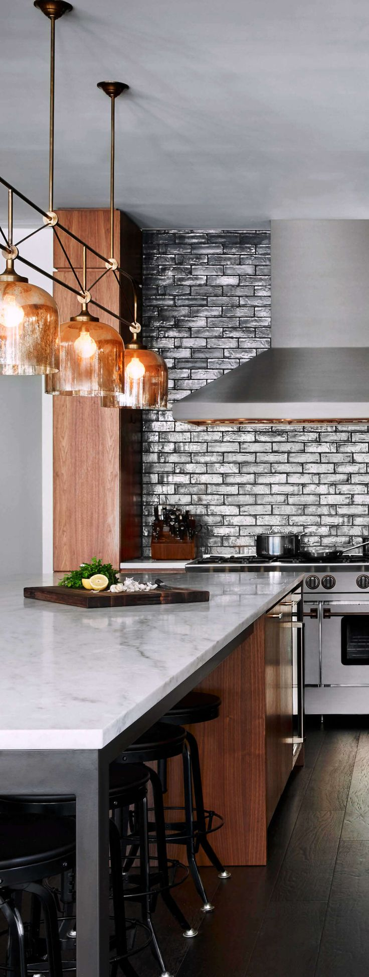 Backsplash Bling: A great mix of materials in this contemporary kitchen with strong architectural lines. Range: BlueStar