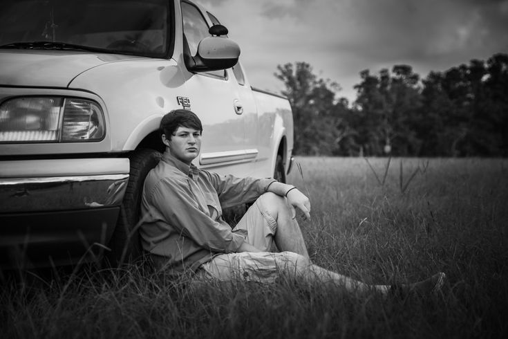 Boy senior pose with truck ford tough Jamie Good Photography