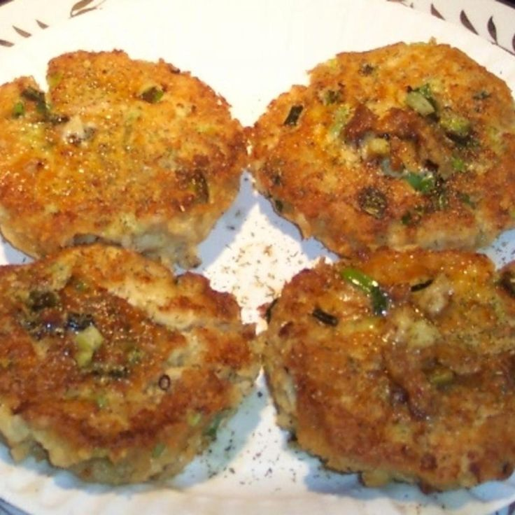 """This recipe has been in my family for many years. I changed the bland original,and tweaked it a bit. Added the gr.onion, lemon juice, and dill seed. Then fried in butter. My friends say it is a """"Recipe to Die For!"""" in a manor of speaking only. The picture of my mom(June E.) and dad (Andy E.)in Chicago 1944 is because he loved salmon,as I do...We could and would eat it cold right from the can!  Must be our Finnish heritage."""