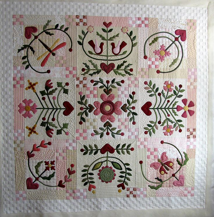 Would be a sweet Valentine's day quilt... pattern is Joy of Life... the quilting on this one is stunning