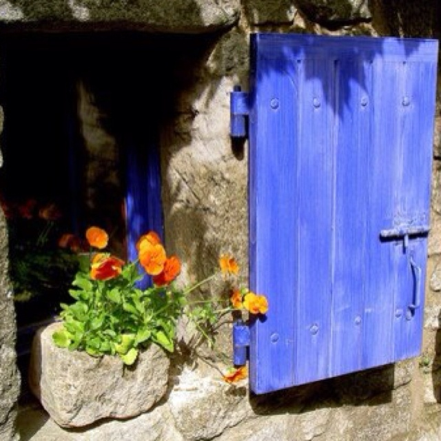 Blue shutter and stone window