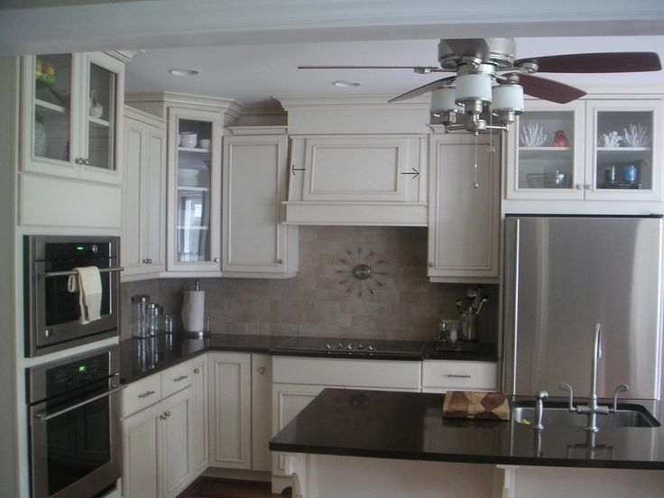 of a couple glass doors adds interest Kraftmaid cabinets in  canvas