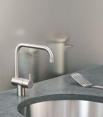 Arne Jacobsen tap, the most copied one around. Still modern after more than 65 years
