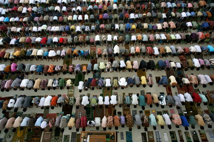 Observing Ramadan | Students perform an afternoon prayer on the first day of the holy fasting month of Ramadan, at Ar-Raudlatul Hasanah Islamic boarding school in Medan, North Sumatra, Indonesia, on July 10, 2013. | The Atlantic/ AP Photo/Binsar Bakkara
