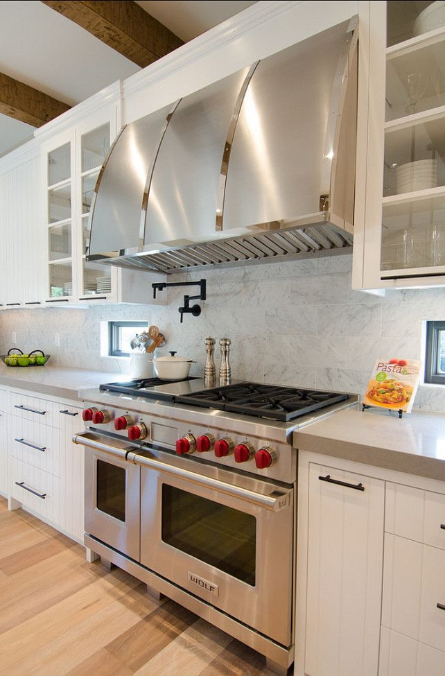 "Stylish Family Home with Transitional Interiors The custom made stainless steel hood is by ""Hanset Metal"" in Portland.  The pot filler is a ""Newport Brass 9485/26 Polished Chrome Pot Fillers East Linear Double""."