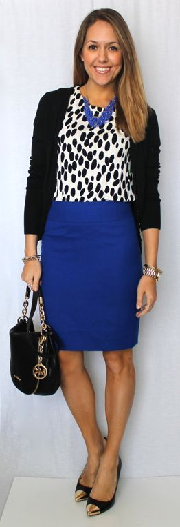 black and white top with cobalt blue necklace