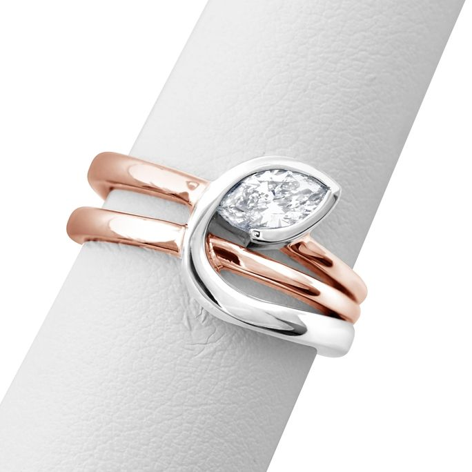 Cool concept and look! TWO TONE MARQUISE DIAMOND RING  3,495.00 Inspired by nature's simplistic beauty, this Mark Michael designed ring features a 0.56ct marquise shaped diamond (G color and SI2 clarity) that is semi-bezel set in 18k white gold. The ring also features 18k rose gold bands.