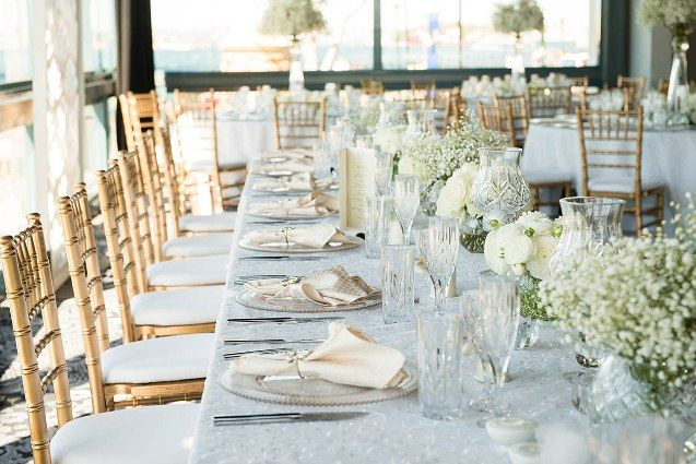 White wedding reception table decorations at The Sebel Pier One Sydney.